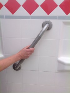 Elcoma Grab Bar installed at an angle in a shower